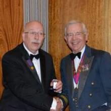 Peter Helmore receives his bar to the Award of Merit in Gold